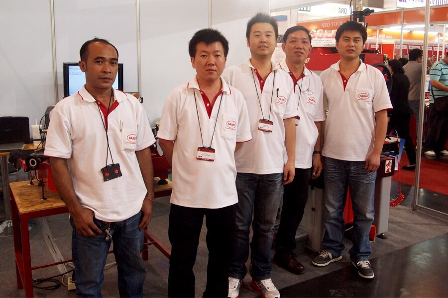 Staff of Parco Intertrade at Metalex in Bangkok with Mr. Kitti Ruangsangthai and Mr. Papon Sirorungsi respectively, second and fourth on the trot.