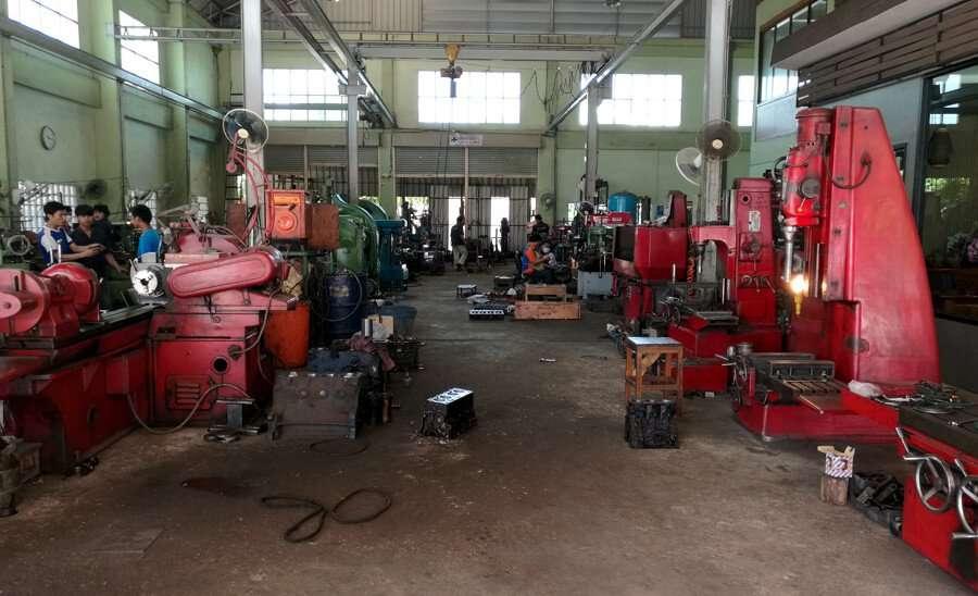 Crankshaft grinders and cylinder boring machines inside the engine repair shop