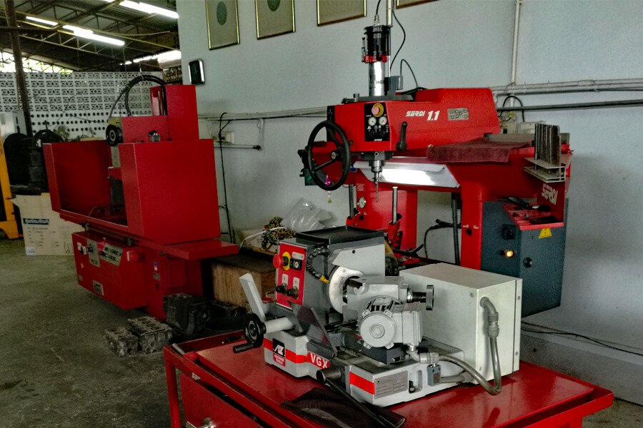 Valve refacer AZ VGX while in the background an engine head resurfacer Berco STC 361 and a Valve seat cutting machine Serdi 1.1